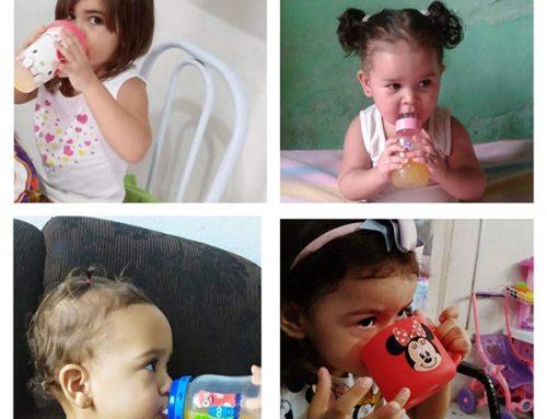 Crianças tomando suco com vitamina C